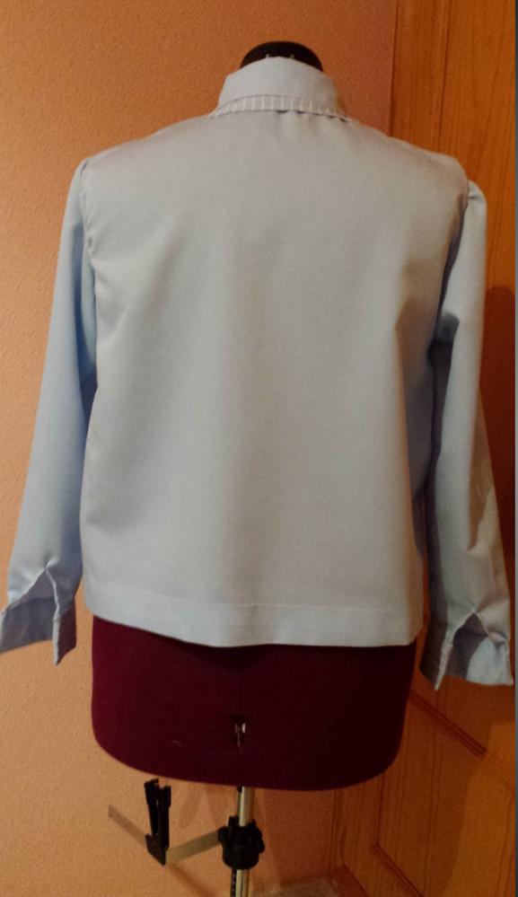 imagen camisa transformada de señora ESPALDA planchada